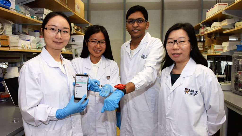 A team of NUS researchers has come up with the pH Watch, an 'add-on' to a wearable health monitoring gadget that can tell users about the condition of their health from their sweat pH. (From left to right) Dr Wang Bo, Ms Chen Yuan, Mr Ananta Narayanan Balaji and Assistant Professor Shao Huilin