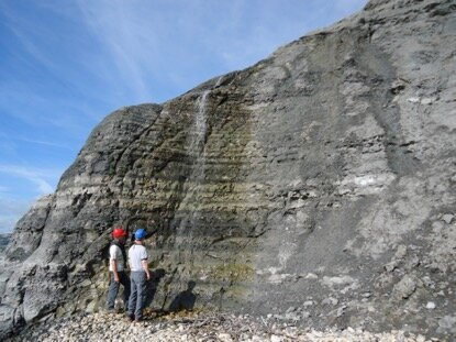 Geologists studying the Lower Jurassic (Pliensbachian) Belemnite Marl Member mudstone succession in Dorset, UK, showing orbitally paced variations of the sediment composition similar to the studied core in Wales. Credit: Dr Micha Ruhl