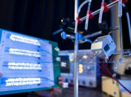 New droplet-based electricity generator generates 140V of power from a drop of water, lighting up 100 LED bulbs.