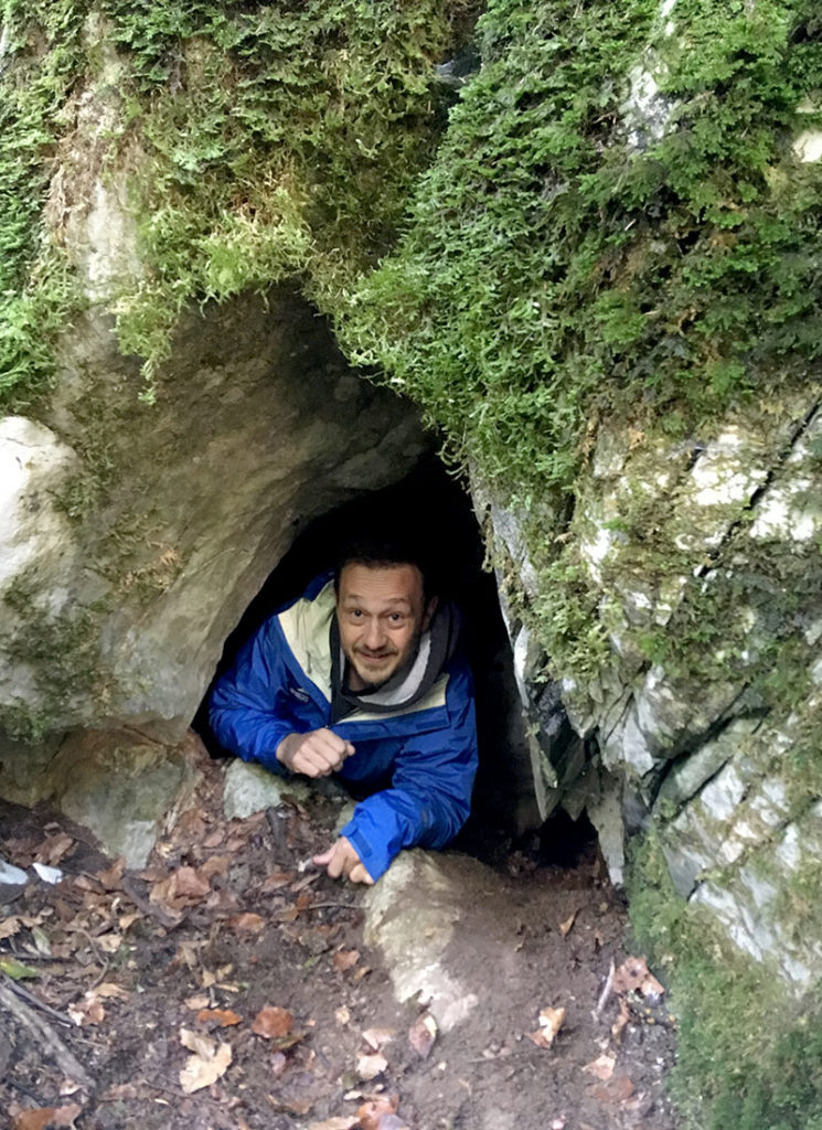 Illinois Natural History Survey wildlife ecologist Max Allen uses camera traps to study wildlife around the world. Here, he is emerging from a brown bear den in Slovenia. Photo courtesy Max Allen