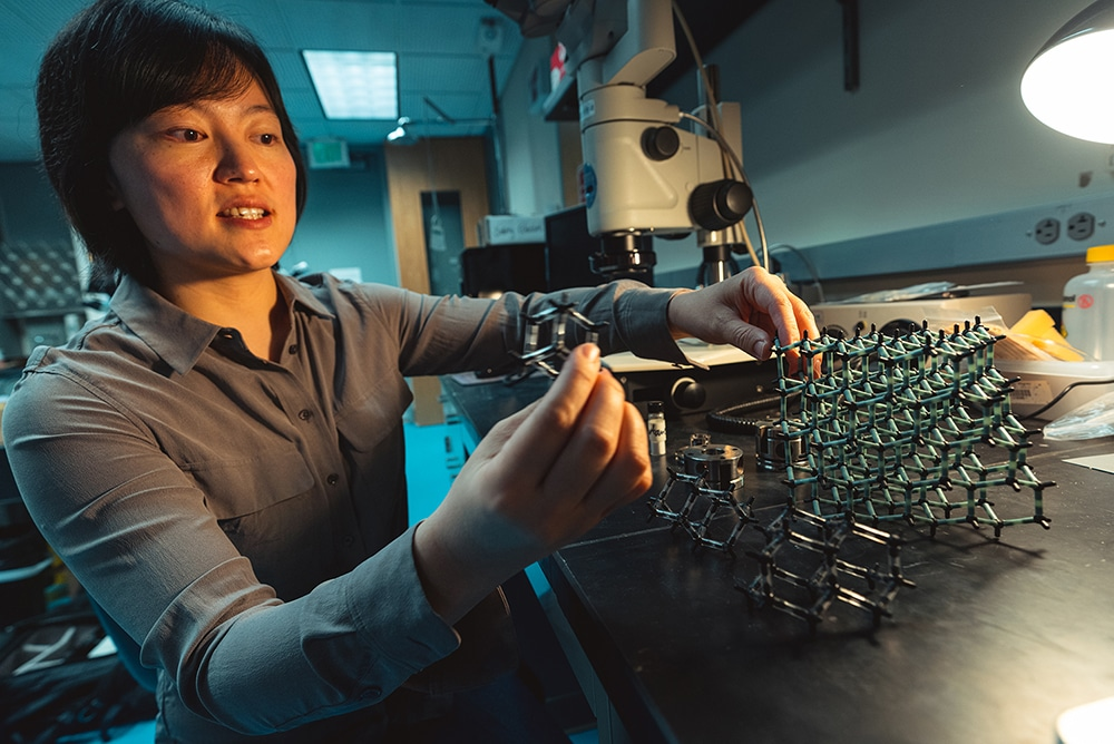 Yu Lin shows models of diamondoids with one, two and three cages, which can transform into the intricate, pure-carbon lattice of diamond.