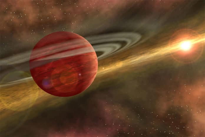 Artist's conception of a massive planet orbiting a cool, young star. In the case of the system discovered by RIT astronomers, the planet is 10 times more massive than Jupiter, and the orbit of the planet around its host star is nearly 600 times that of Earth around the sun.
