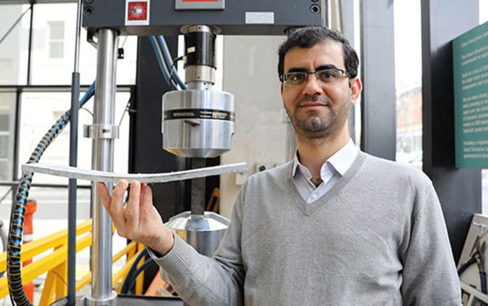 Dr Behzad Nematollahi with a sample of the novel concrete developed at Swinburne.