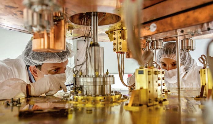 Researchers work on the cryostat for the CUORE experiment. (Credit: CUORE Collaboration)