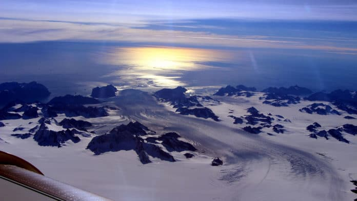 GRACE, GRACE-FO Satellite Data Track Ice Loss at the Poles Greenland's Steenstrup Glacier, with the midmorning sun glinting off the Denmark Strait in the background. The image was taken during a NASA IceBridge airborne survey of the region in 2016. Credit: NASA/Operation IceBridge