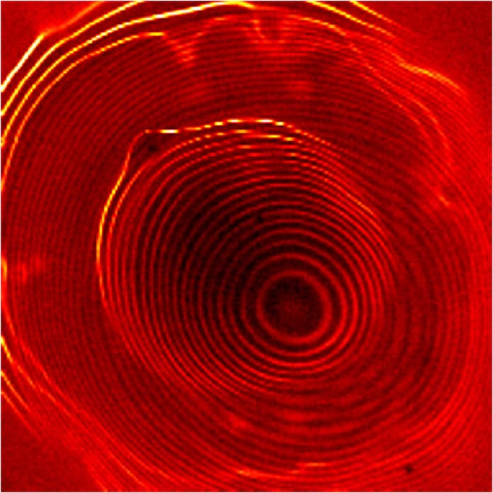 Image of a novel system of coupled quantum dots taken with a scanning tunneling microscope shows electrons orbiting within two concentric sets of closely spaced rings, separated by a gap. The inner set of rings represents one quantum dot; the outer, brighter set represents a larger, outer quantum dot. Credit: NIST