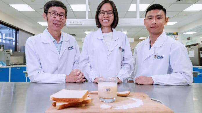 NUS food scientists Assoc Prof Liu Shao Quan (left), Miss Nguyen Thuy Linh (centre) and Dr Toh Mingzhan (right) came up with a patented zero-waste process to make a new probiotic beverage using unsold bread. Credit: National University of Singapore