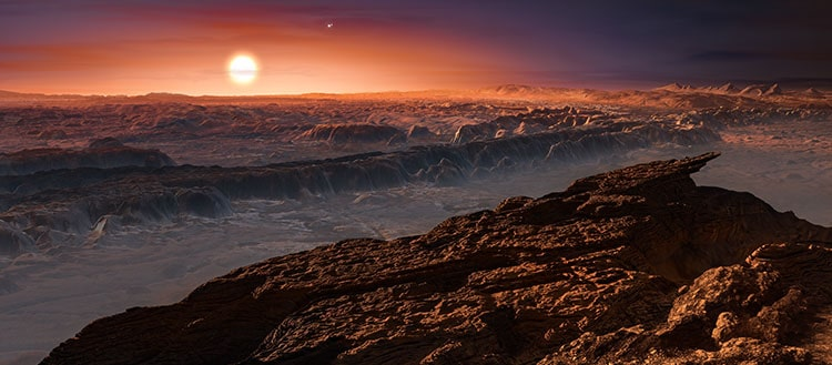 This artist's impression shows a view of the surface of the planet Proxima b orbiting the red dwarf star Proxima Centauri, the closest star to the Solar System. © ESO/M. Kornmesser