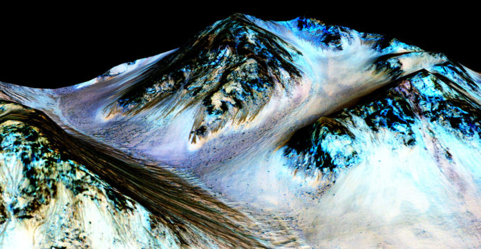 Courtesy of NASA/JPL-Caltech/University of Arizona An SwRI scientist modeled the climate of Mars to understand if hydrated salts or brines on the surface of the Red Planet could harbor life. The results suggest that hydrated salts and brines on Mars are not supportive of life. For example, if the dark streaks shown here are formed by the flow of briny water, then that briny water would be too cold to support life.