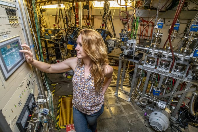 Jennifer Pore, a Berkeley Lab project scientist who led the study detailing the discovery of mendelevium-244, operates the Berkeley Gas-filled Separator vacuum controller at Berkeley Lab's 88-Inch Cyclotron in this 2018 photo