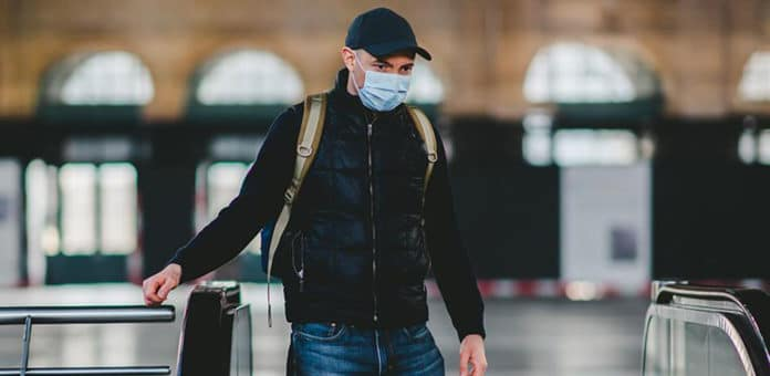Man wearing face covering to protect against COVID-19