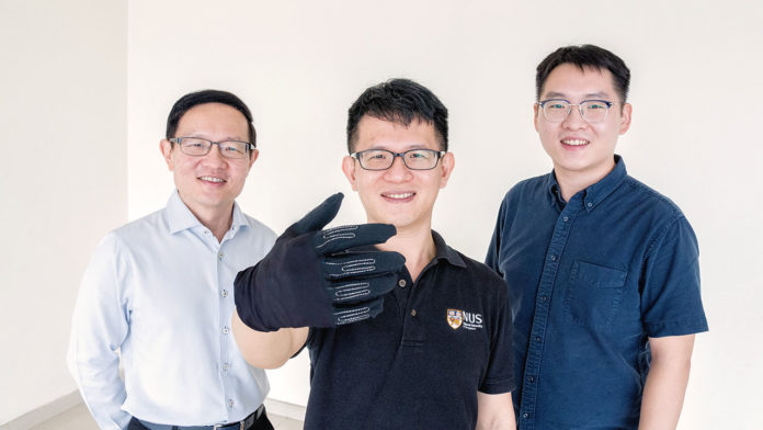 The Infinity GloveTM was developed by a team of NUS researchers led by Professor Lim Chwee Teck (left). With him are two members of the research team, Dr Yeo Joo Chuan (centre) and Dr Yu Longteng (right). Credit: National University of Singapore