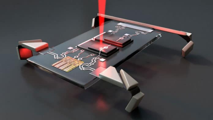 Laser jolts microscopic electronic robots into motion.