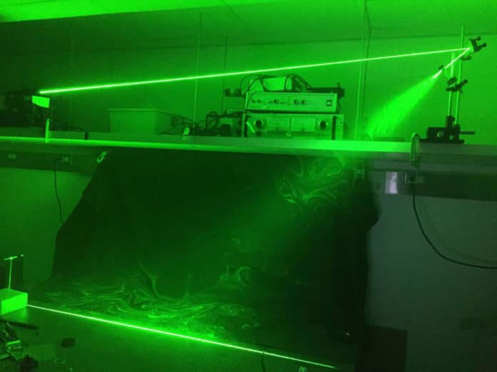 The researchers used this laser sheet to illuminate the saliva droplets. The laser light