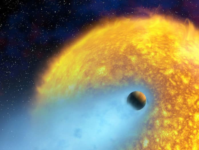 artist conception of an exoplanet whose atmosphere is being torn off by the radiation
