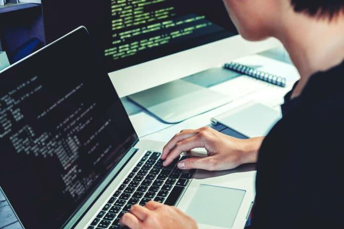 Man writing algorithms