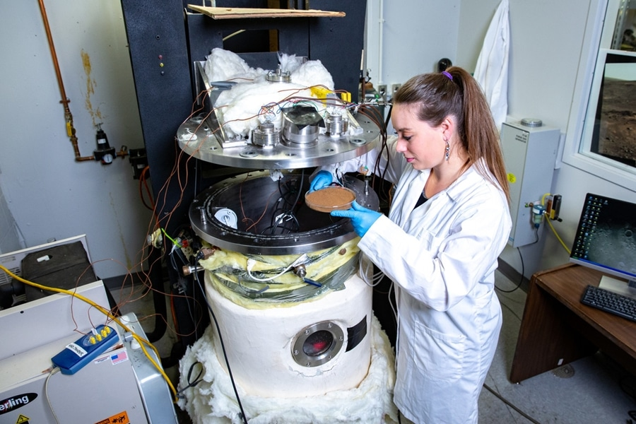 Researcher Rachel Slank works with the university's Mars chamber