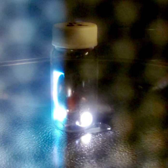 sparks are generated inside a glass vial containing coal powder and copper foil