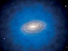 Artist's impression of a spiral galaxy embedded in a larger distribution of invisible dark matter, known as a dark matter halo