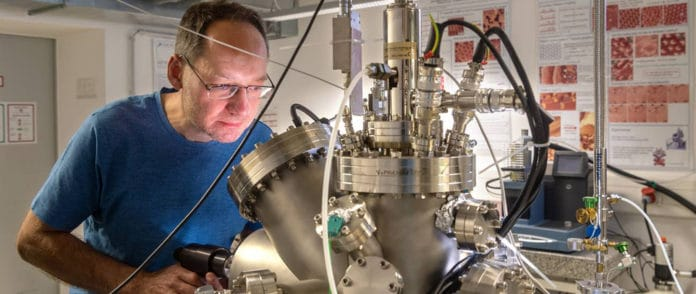 Markus Lackinger transferring a sample inside the ultra-high vacuum chamber by means of a vacuum grabber. This vacuum chamber contains all facilities for preparing and analyzing samples under vacuum