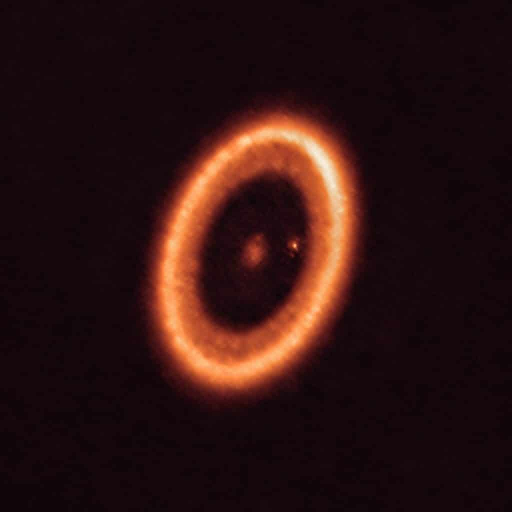 The PDS 70 system as seen with ALMA