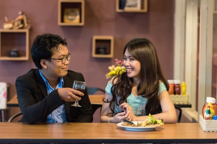 two person communicating in cafe