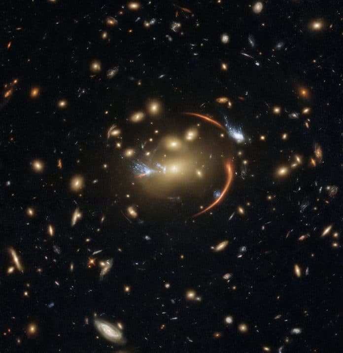 The slumbering giant galaxy at the center of this image is 10 billion light-years away